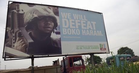 Une affiche de campagne du gouvernement pour promouvoir sa lutte anti-Boko Haram, le 3 juillet 2015. Photo: PIUS UTOMI EKPEI/AFP