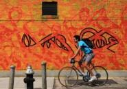 Le graffeur tunisien El Seed enchante, en calligraphie arabe, les murs de New-York