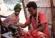 Soudan: un tailleur reprise les vêtements et le coeur des réfugiés du Tigré
